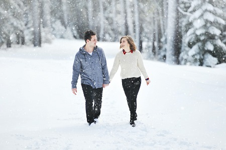 winter couples walking in snow
